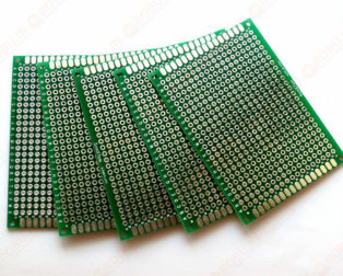 """15 x 20 cm Universal PCB Prototype Board Double-SideHigh-quality double sided universal prototyping board with standard 0.1"""" spacing through holes.High-quality 15x20 cm FR4 mat"""